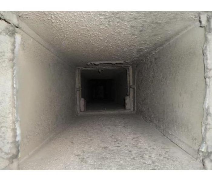 Air ducts inside of a commercial building covered with dust